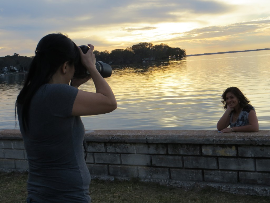 EUSTIS, Florida (Feb. 5, 2013) Photographer Bonnie Whicher captures model Melissa Bolton on the edge of Lake Eustis at Ferran Park. After various preparations, Whicher is able to successfully capture her subject. (Photo by: Michelle Turner/Full Sail University).