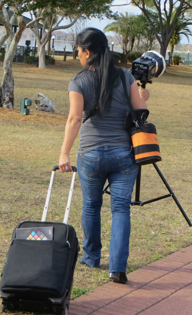 EUSTIS, Florida (Feb. 5, 2013) Photographer Bonnie Whicher carries her own equipment during her photo shoot on location in Ferran Park. When working alone, Whicher must manage more than her camera and her subject. (Photo by: Michelle Turner/ Full Sail University).